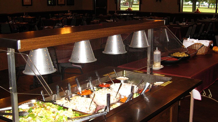 Buffet style dinner salad bar.