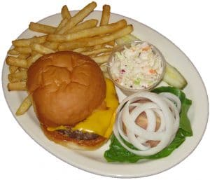 Cheeseburger, fries and coleslaw dinner plate. Onions, pickles lettuce and tomato included.