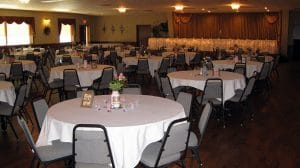 KC Hall seating with wedding reception table setup. Seating capacity 300 guests.