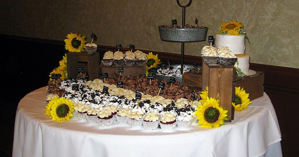 Wedding reception cupcake table with sunflowers on 8/3/19.